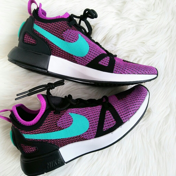 low priced 9e9e7 ae62d Nike Duel Racer Knit Sneakers